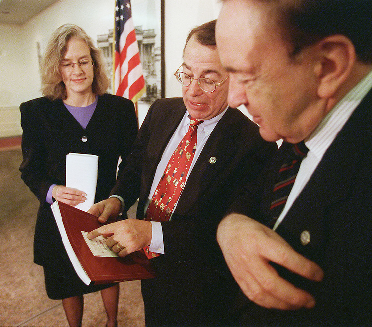 11/5/99.MANAGED CARE--Greg Ganske, R-Iowa, shows Joanne Hustead, director of Legal and Public Policy for the.National Partnership for Women & Families, and Steve Horn, R-Calif., a copy of the Employee Health Benefits 1999 Annual Survey by the Kaiser Family Foundation after a news conference on the managed care conference.