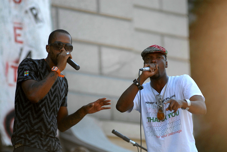 24 Aug 08: The Stic.man (left) and M-1 of the hip hop duo Dead Prez performs on the steps of the Colorado state capitol building. On the day before the Democratic National Convention is scheduled to begin about 1,500 people participated in the ReCreate 68 rally, which included a march from the Colorado state capitol building to the Pepsi Center.