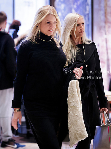 Florida Attorney General Pam Bondi (L) walks through the lobby of Trump Tower reportedly on route to a meeting with President-elect Donald Trump in New York, New York, USA, 02 December 2016.<br /> Credit: Justin Lane / Pool via CNP