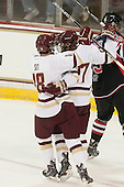 Michael Sit (BC - 18), Quinn Smith (BC - 27) - The Boston College Eagles defeated the visiting University of New Brunswick Varsity Reds 6-4 in an exhibition game on Saturday, October 4, 2014, at Kelley Rink in Conte Forum in Chestnut Hill, Massachusetts.