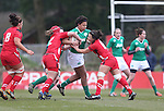 Wales pair Sian Williams and Carys Phillips stop Ireland lock Sophie Spence.<br /> 6 Nations Championship<br /> Wales v Ireland Women<br /> St Helens Swansea<br /> 15.03.15<br /> &copy;Steve Pope - SPORTINGWALES