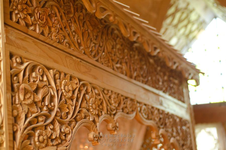 Interior detail views of carved woodwork in master bedroom of traditional Kashmiri houseboat, Dal Lake, Srinagar, Kashmir, India.