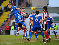 Lincoln City's Lee Frecklington beats Notts County's Daniel Jones to the ball<br /> <br /> Photographer Chris Vaughan/CameraSport<br /> <br /> The EFL Sky Bet League Two - Lincoln City v Notts County - Saturday 13th January 2018 - Sincil Bank - Lincoln<br /> <br /> World Copyright &copy; 2018 CameraSport. All rights reserved. 43 Linden Ave. Countesthorpe. Leicester. England. LE8 5PG - Tel: +44 (0) 116 277 4147 - admin@camerasport.com - www.camerasport.com