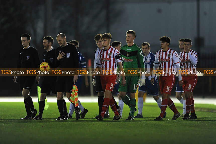 Players from both sides enter the pitch during Wigan Athletic Youth vs Stevenage Youth, FA Youth Cup Football at Robin Park Arena, Wigan, England on 17/12/2015