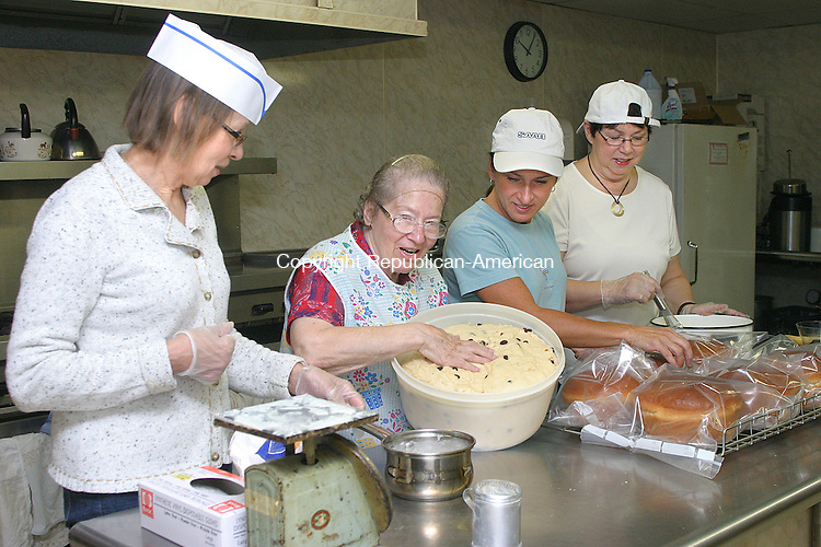 WATERBURY CT.-20 OCTOBER 2011 102011DA01- The ladies of St. Mary's Orthodox Church in Waterbury, from left, Carolyn Palleria, Vera Hubobanko, Ester Zinolli, and Mary Ellen Zobbi prepare Babka on Thursday that will be sold during the churches Annual Ethnic Food Fest. The festival will also offer many European inspired foods, ethnic and religious items will be sold. The Bristol Old Tyme Fiddlers will be playing from 12pm-3pm, tag sale items will also be sold along with gift baskets. The event will take place Saturday at the St. Mary's Orthodox Church in Waterbury from 10am-4pm.<br /> Darlene Douty Republican American