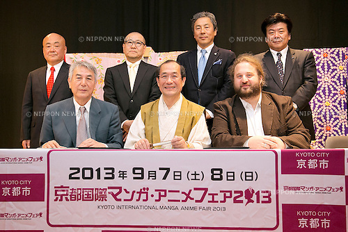 """April 24, 2013, Tokyo, Japan - The organizers of """"Kyoto international Manga Anime Fair 2013"""" pose for cameras at the press conference in Kabukiza Tower, Tokyo. In the press conference the organizers of KYOMAF, Mayor of Kyoto and Japan EXPO (in France) signed a document to collaborate together to promote the anime and manga culture in Europe and United States. The KYOMAF is the largest manga/anime fair in West Japan and will be free entrance for elementary school students and foreigners with passport. It will be held from September 6 to 8 at Miyako Messe, Kyoto. (Photo by Rodrigo Reyes Marin/AFLO).."""