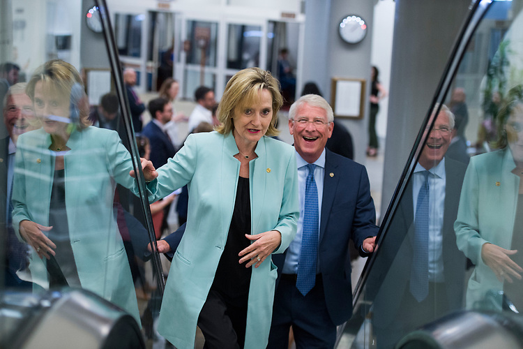 UNITED STATES - JUNE 26: Sens. Cindy Hyde-Smith, R-Miss., and  Roger Wicker, R-Miss., talk before the Senate Policy luncheons in the Capitol on June 26, 2018. (Photo By Tom Williams/CQ Roll Call)