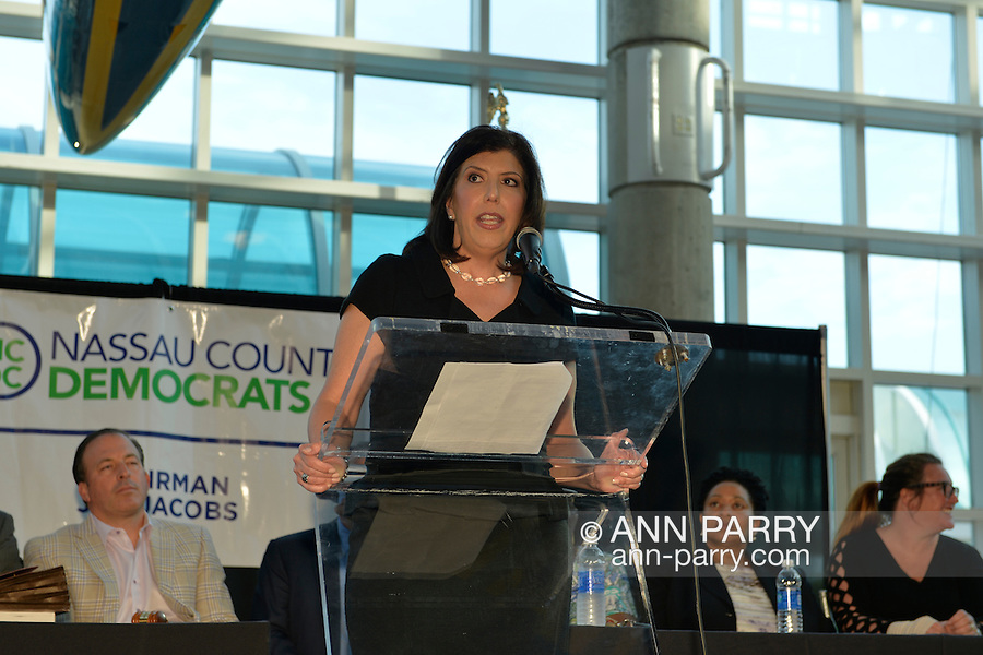 MADELINE SINGAS, Acting District Attorney of Nassau County, speaks at the podium during the Nassau County Democrats nominating convention. Singas, a Greek-American, who is running for Nassau County D.A., became acting DA when D.A. Rice resigned to join Congress, and is one of 55 candidates the executive committee nominated for races.