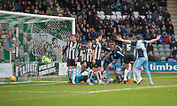 Gozie Ugwu of Wycombe Wanderers (centre) emerges from a goalmouth scramble after scoring his side's first goal during the Sky Bet League 2 match between Plymouth Argyle and Wycombe Wanderers at Home Park, Plymouth, England on 30 January 2016. Photo by Mark  Hawkins / PRiME Media Images.