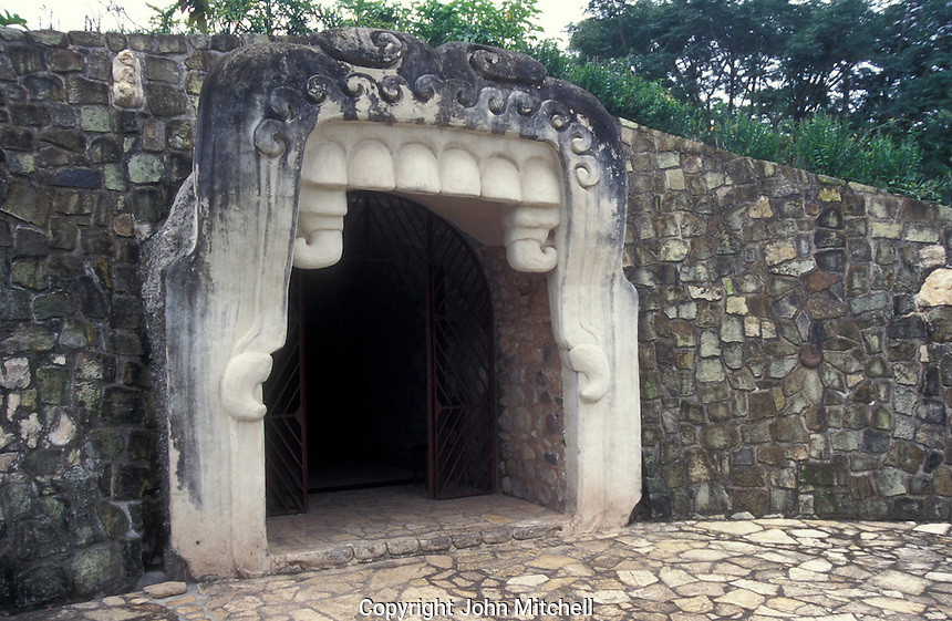 Entrance to the Copan Sculpture Museum at the Mayan ruins of Copan, Honduras. The entranceway to this museum is modeled after a Mayan Earth Monster.