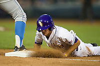 LSU Tiger outfielder Mark Laird (9) dives back to first base after a pickoff attempt during Game 4 of the 2013 Men's College World Series against the UCLA Bruins on June 16, 2013 at TD Ameritrade Park in Omaha, Nebraska. UCLA defeated LSU 2-1. (Andrew Woolley/Four Seam Images)