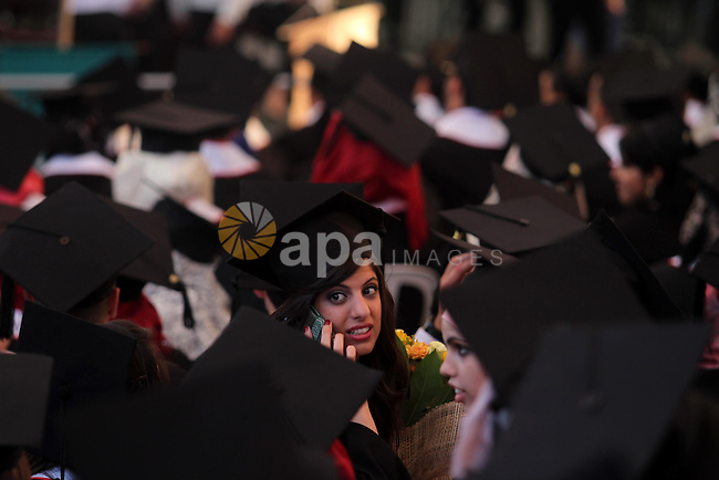 Palestinian students attend their graduation ceremony at the Birzeit University near the West Bank city of Ramallah, June 26, 2014. Photo by Issam Rimawi