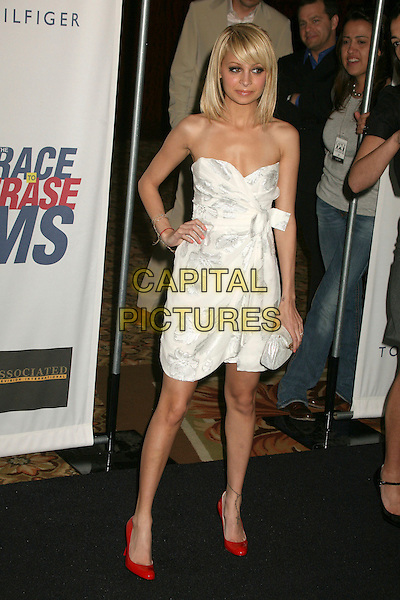 "NICOLE RICHIE.14th Annual Race to Erase MS Themed ""Dance to Erase MS"" at the Century Plaza Hotel, Century City, California, USA, 13 April 2007..full length strapless dress fringe blonde bob hair hand on hip white bow red shoes tattoo on ankle kabbalah bracelet.CAP/ADM/BP.©Byron Purvis/AdMedia/Capital Pictures."