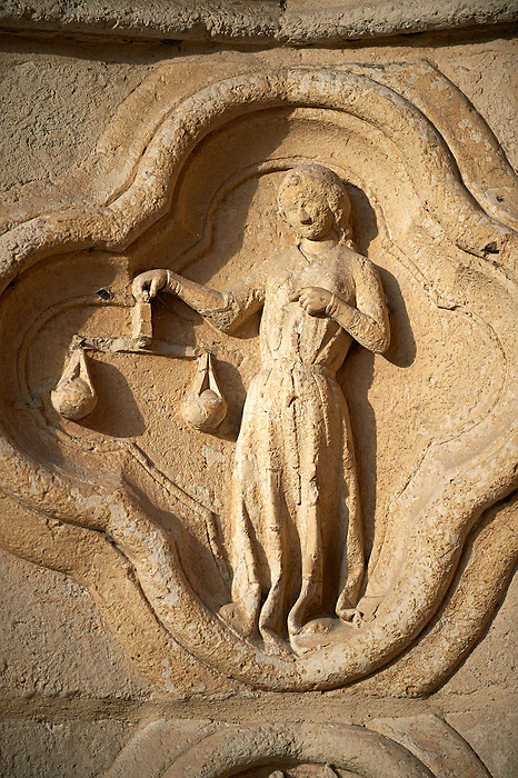 Gothic sculpture depicting The Libre sign of the zodiac on the west entrance of the Cathedral of Notre-Dame, Amiens, France