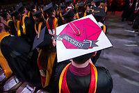 NWA Democrat-Gazette/BEN GOFF @NWABENGOFF<br /> Logan Sublett of Hot Springs, graduating with a master of science in mathematics, wears a decorated mortar board Saturday, May 11, 2019, during the University of Arkansas all university commencement ceremony in Bud Walton Arena in Fayetteville.
