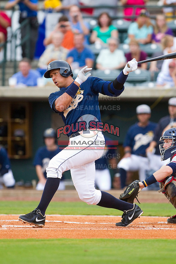 Alex Rodriguez of the New York Yankees follows through on his swing for the Charleston RiverDogs against the Rome Braves at Joseph P. Riley Park on July 2, 2013 in Charleston, South Carolina.  The RiverDogs defeated the Braves 4-2.   (Brian Westerholt/Four Seam Images)