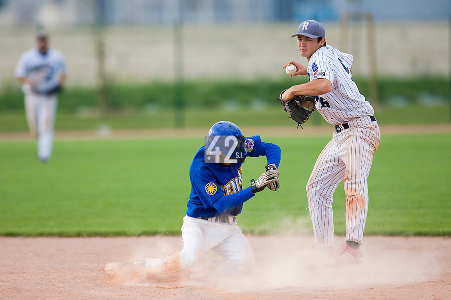 12 Aug 2007: Kenji Hagiwara throws to first base for a double play during game 5 of the french championship finals between Templiers (Senart) and Huskies (Rouen) in Chartres, France. Huskies defeated Templiers 9-8 to win their fourth french championship.
