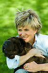 Mature woman hugging dog, close-up