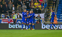 Kenneth Zohore of Cardiff City (far left) celebrates scoring his side's first goal during the Sky Bet Championship match between Cardiff City and Leeds United at the Cardiff City Stadium, Cardiff, Wales on 26 September 2017. Photo by Mark  Hawkins / PRiME Media Images.