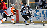 OMAHA, NE - FEBRUARY 9:  Eric Scheid #39 from the Lincoln Stars controls the puck in front of Tyler Moy #2 from the Omaha Lancers in the second period at the Battle on Ice Saturday at TD Ameritrade in Omaha, NE. (Photo by Schyler Eggen/Inertia)