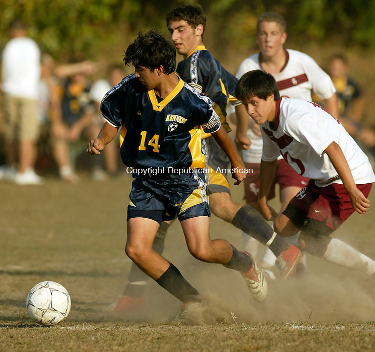 WATERBURY, CT 10/08/07- 100807BZ10- Kennedy High's Nick Moutinho (8) maneuvers the ball under pressure from Sacred Heart's Cisco Robalino (10) during their game at Bucks Hill Park in Waterbury Monday. <br /> Jamison C. Bazinet Republican-American