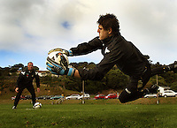 Reece Crowther makes a save as new goaklkeeping coach Jonathan Gould (left) looks on during the Wellington Phoenix A-League football training session Training Session at Newtown Park, Wellington, New Zealand on Monday, 4 May 2009. Photo: Dave Lintott / lintottphoto.co.nz