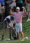 Cromwell, CT-22 JUNE 22 2018-062219MK19 Paul Casey mugs for the crowd after taking his shoes off to hit while standing in the water alongside the 15th fairway Saturday afternoon during the third round of the 2019 Travelers Championship at the TPC River Highlands in Cromwell. Michael Kabelka / Republican-American