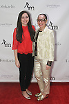 Olivia Esterlis (left) and Norma Ingui attend the 3rd Annual Wives' Holiday Soiree at Totokaelo in SOHO on December 9, 2015.