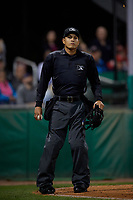Umpire Cliburn Rondon during a NY-Penn League Semifinal Playoff game between the Lowell Spinners and Batavia Muckdogs on September 4, 2019 at Dwyer Stadium in Batavia, New York.  Batavia defeated Lowell 4-1.  (Mike Janes/Four Seam Images)