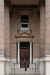 Havana, Cuba; large wooden doors and a metal gate block the entrance to the former Banco Nacional de Cuba, this neoclassical building with fluted Corinthian columns now houses the Ministry of Finance and Prices
