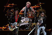 "CIUDAD DE MÉXICO, Octubre 27, 2013.  El cantante Steven Tyler, el guitarrista Joe Perry y el baterista Joey Kramer, del grupo de rock estadounidense, Aerosmith, durante su concierto en la Arena de la Ciudad de México, el 27 de octubre de 2013. Aerosmith llega a México en el  ""The Global Warming Tour"".  FOTO: ALEJANDRO MELÉNDEZ<br /> <br /> MEXICO CITY, Oct. 27, 2013. The singer Steven Tyler, guitarist Joe Perry and drummer Joey Kramer, the American rock band, Aerosmith, during their concert at the Arena Mexico City, on October 27, 2013. Aerosmith arrives in Mexico on ""The Global Warming Tour"". PHOTO: ALEJANDRO MELENDEZ"
