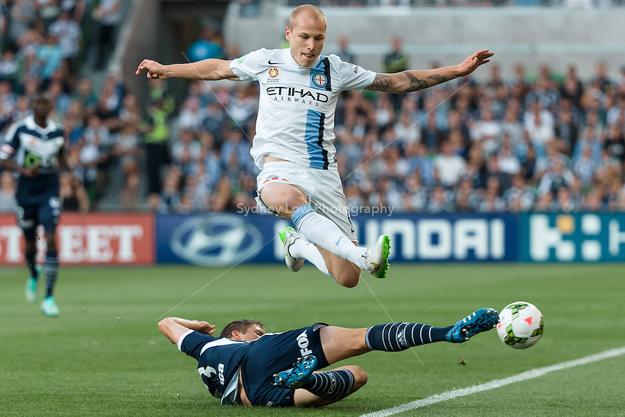 Adrian LEIJER of the Victory clears the ball from Aaron MOOY of Melbourne City kicks the ball in round 11 A-League match between Melbourne City and Melbourne Victory at AAMI Park in Melbourne, Australia during the 2014/2015 Australian A-League season. City def Victory 1-0