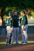 AZL Athletics Green pitching coach Gabriel Ozuna (39) talks to catcher Hansen Lopez (6) and starting pitcher Dennis Herrera (32) during an Arizona League game against the AZL Dodgers Lasorda at Camelback Ranch on June 19, 2019 in Glendale, Arizona. AZL Dodgers Lasorda defeated AZL Athletics Green 9-5. (Zachary Lucy/Four Seam Images)