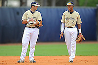 4 March 2012:  FIU infielder Mike Martinez (40) enjoys a light moment with shortstop Julius Gaines (2) as the FIU Golden Panthers defeated the Brown University Bears, 8-3, at University Park Stadium in Miami, Florida.