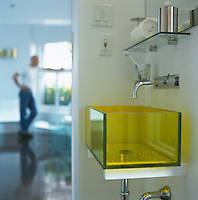 The glass basin was designed by Denis Blais in acid yellow