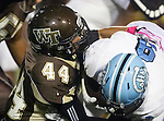 Torrance, CA 10/02/15 - Floyd Willis II (Carson #9) and \w44\ in action during the Carson-West Torrance CIF varsity football game at West Torrance High School.  Carson defeated West Torrance 34-27.