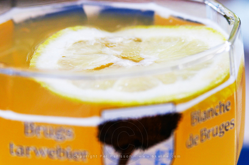 Closeup of a glass of white beer (wheat beer, biere blance) with a slice of lemon.  Vienne, Isère Isere, France, Europe