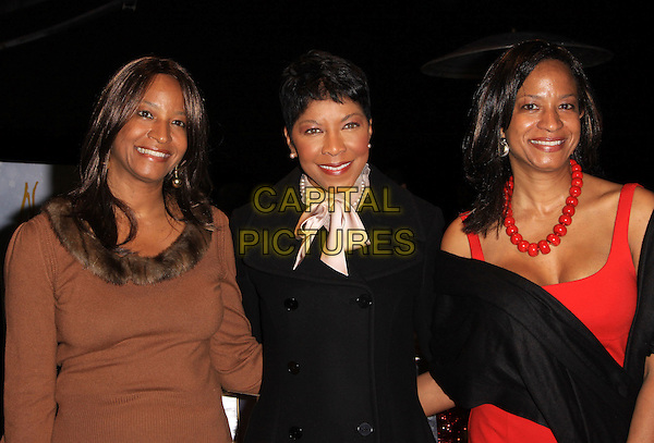 NATALIE COLE &amp; sisters Timolin &amp; Casey<br /> Natalie Cole Lights Capitol&iacute;s Legendary Rooftop Christmas Tree. Held At Capitol Records Rooftop, Hollywood, California, USA.<br /> November 19th, 2009<br /> half length black gold silk satin scarf red dress brown necklace top switch on pink  siblings family brown red <br /> CAP/ADM/KB<br /> &copy;Kevan Brooks/AdMedia/Capital Pictures
