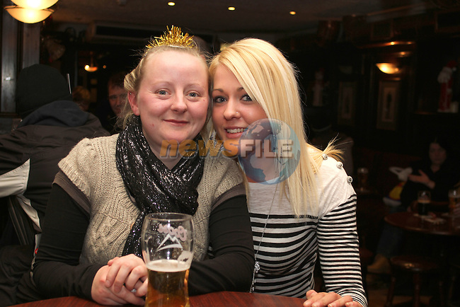 Jessica Everitt and Audrey McQuillan on Christmas Eve in the Laurence Inn. ..(Photo credit should read Jenny Matthews www.newsfile.ie)....This Picture has been sent you under the conditions enclosed by:.Newsfile Ltd..The Studio,.Millmount Abbey,.Drogheda,.Co Meath..Ireland..Tel: +353(0)41-9871240.Fax: +353(0)41-9871260.GSM: +353(0)86-2500958.email: pictures@newsfile.ie.www.newsfile.ie.