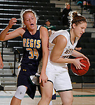 JANUARY 30, 2015 -- Courtney Patterson #24 of Black Hills State shields a rebound from Karlyn Johnson #34 of Regis University during their Rocky Mountain Athletic Conference women's basketball game Friday evening at the Donald E. Young Center in Spearfish, S.D.  (Photo by Dick Carlson/Inertia)
