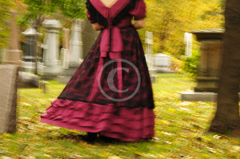 Canada, Montreal, Mount Royal Cemetery, woman with period dress, walking, low angle view