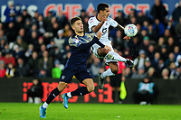 Patrick Schmidt of Barnsley battles with Kyle Naughton of Swansea City during the Sky Bet Championship match between Swansea City and Barnsley at the Liberty Stadium in Swansea, Wales, UK. Sunday 29 December 2019