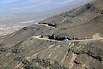 Car driving on unsurfaced road, Atlantic Ocean coast, Jandia peninsula, Fuerteventura, Canary Islands, Spain