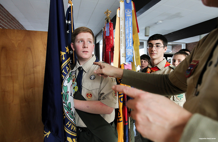 Portsmouth, N.H., Sunday, Feb. 9, 2014:  Boy Scout and flag bearer Hayden Diemer, left, 17 of Portsmouth takes direction before the start of the ceremony as fellow scout Jack Rodgers, 16, of Portsmouth, right, looks on.  Portsmouth Boy Scout troop 164 held an Eagle Scout Court of Honor ceremony at North Church Parish House for Alex Bock and Colin Yost both of whom achieved Eagle Scout status. Portsmouth Herald Photo Cheryl Senter