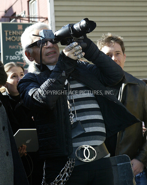 WWW.ACEPIXS.COM . . . . .***EXCLUSIVE!!! FEE MUST BE NEGOTIATED BEFORE USE!!!***....NEW YORK, MARCH 22, 2005....Karl Lagerfeld shoots an exclusive fashion shoot outside the Soho Chanel boutique. Accompanied by Visionaire creator Stephen Gan, Lagerfeld makes a scene with a mob sized entourage. Could this be a layout for the next Visionaire? Karl even takes a moment to chat with model Karolina Kurkova.....Please byline: Ian Wingfield - ACE PICTURES..... *** ***..Ace Pictures, Inc:  ..Craig Ashby (212) 243-8787..e-mail: picturedesk@acepixs.com..web: http://www.acepixs.com