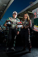 Sept. 19, 2010; Concord, NC, USA; NHRA funny car drivers John Force (left) and daughter Ashley Force Hood pose for a portrait during the O'Reilly Auto Parts NHRA Nationals at zMax Dragway. Mandatory Credit: Mark J. Rebilas-
