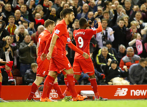 25.10.2015. Anfield, Liverpool, England. Barclays Premier League. Liverpool versus Southampton. Liverpool striker Christian Benteke celebrates after scoring his team's first goal and signals to the bench.