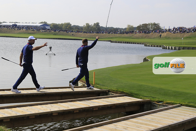 Paul Casey and Tyrell Hatton Team Europe walk onto the 18th green during Friday's Fourball Matches at the 2018 Ryder Cup, Le Golf National, Iles-de-France, France. 28/09/2018.<br /> Picture Eoin Clarke / Golffile.ie<br /> <br /> All photo usage must carry mandatory copyright credit (© Golffile | Eoin Clarke)