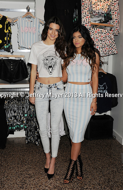 GLENDALE, CA- NOVEMBER 09: TV personalities Kendall Jenner (L) and Kylie Jenner attend the launch of the PacSun 'Kendall & Kylie Holiday Collection' at Glendale Galleria on November 9, 2013 in Glendale, California.