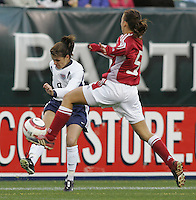 06 November,  2004.  USWNT forward Mia Hamm (9)has her cross blocked by Bettina Falk (5) of Denmark at  Lincoln Financial Field in Philadelphia, Pa.